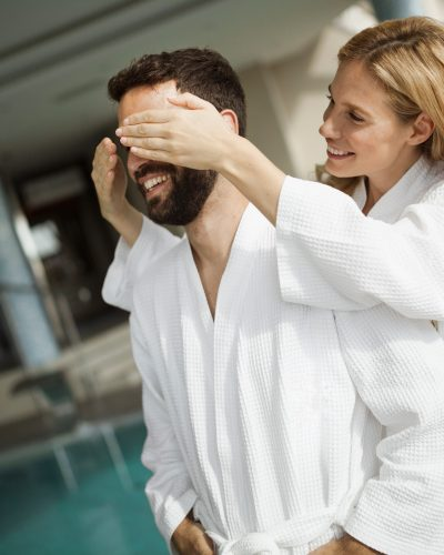 Portrait of attractive cheerful couple in spa center